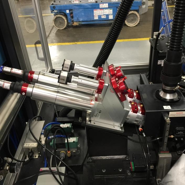 Fiber laser drilling optics